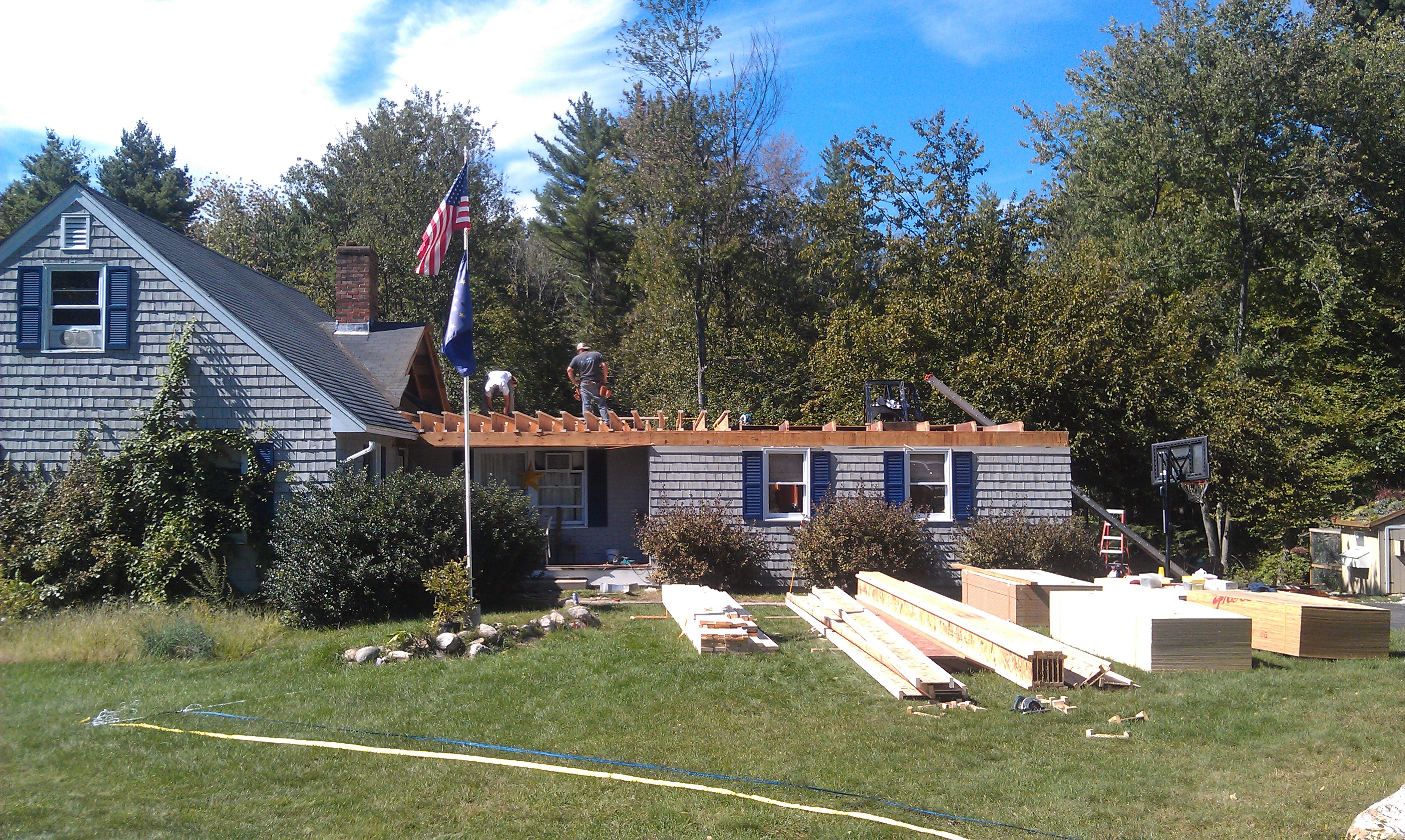 Removing the roof of a house in Bedford NH | Allen Remodeling